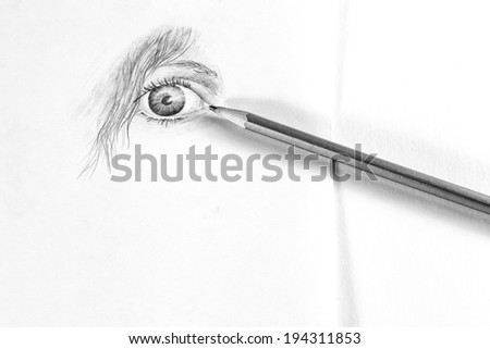 Pencil sketch of female eye on white paper with pencil - black and white - stock photo