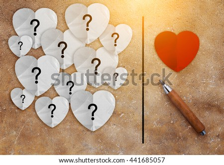 pencil with red heart and white paper with question mark inside love concept on brown texture background.jpg - stock photo