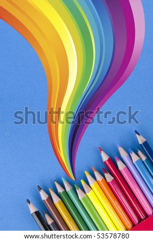 Pencils and rainbow - stock photo
