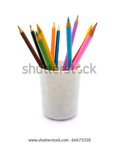 Pencils in a glass on a white background. - stock photo