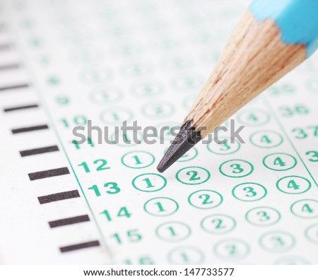 Pencils point at choice No. 1  on blank test sheet close up - stock photo