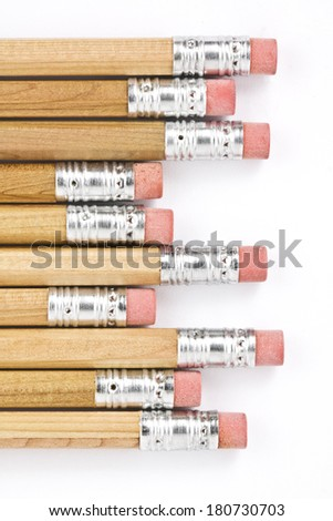 pencils with erasers on the ends isolated on white - stock photo