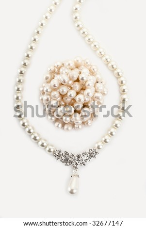 Pendant on pearl chain. Isolated on light background - stock photo