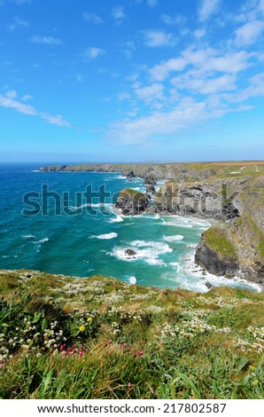 Pendarves Island at Bedruthan Steps viewed from Carnewas Point Cornwall England - stock photo
