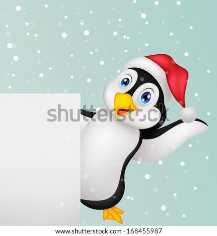 Penguin cartoon with blank sign - stock photo