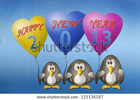Penguins hold balloon 2013  paper craft on paper background - stock photo