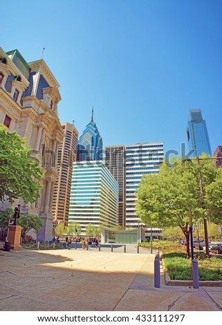 Penn Square and Penn Center and skyline of skyscrapers in Philadelphia, in Pennsylvania, USA. It is central business district in Philadelphia. Tourists nearby - stock photo