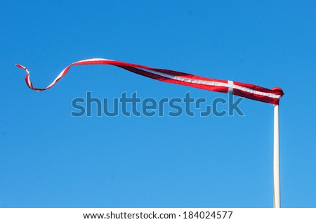 Pennant with the flag of Denmark blowing in the wind - stock photo
