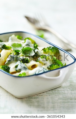 Penne baked with mozzarella and broccoli - stock photo