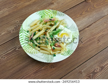 Penne Florentine with bacon and poached egg - stock photo