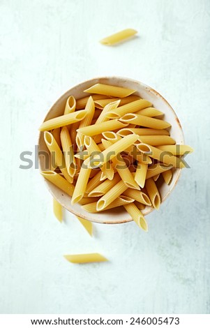 Penne pasta in a ceramic bowl  - stock photo