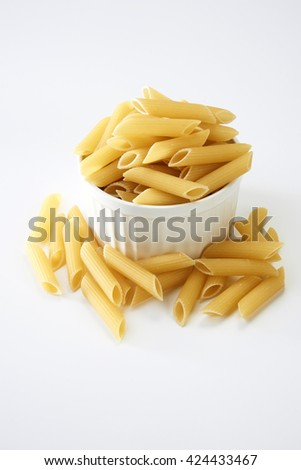 penne pasta on the white background - stock photo