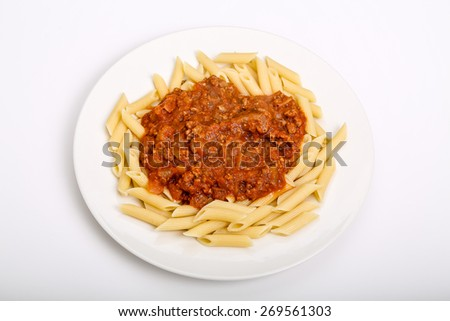 Penne pasta topped with fresh bolognese sauce - stock photo