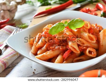 Penne pasta with chili sauce arrabiata - stock photo
