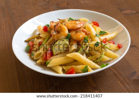Penne with zucchini and shrimps, italian cuisine - stock photo