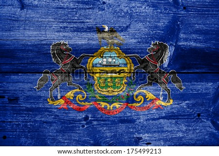 Pennsylvania State Flag painted on old wood plank texture - stock photo