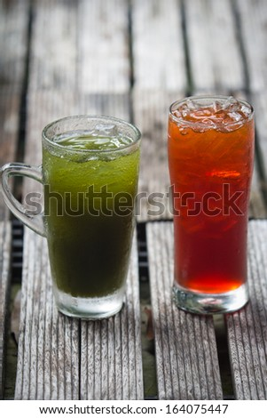 Pennywort or asiatic herbal drink and ice tea in glass - stock photo