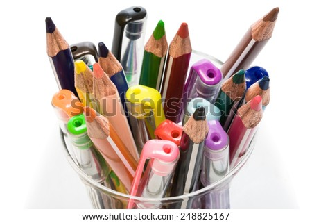 pens and pencils in a glass on a white background - stock photo