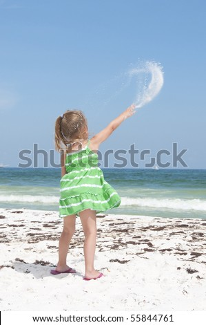PENSACOLA BEACH - JUNE 23: An unidentified young girl plays with sand near oil patches on June 23, 2010 in Pensacola Beach, FL. - stock photo