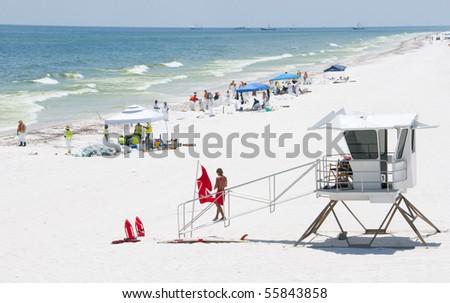 PENSACOLA BEACH - JUNE 23: The beach area is shown on June 23, 2010 in Pensacola Beach, FL. - stock photo