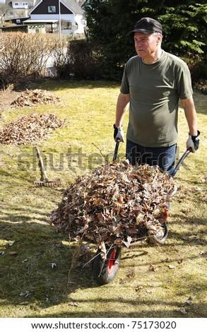 Pensioner gardening recreation - stock photo