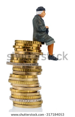 pensioner sitting on a pile of money, symbol photo for pensions, retirement, pension - stock photo
