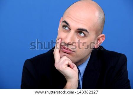 Pensive bald man - stock photo