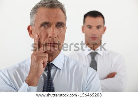 Pensive business team - stock photo