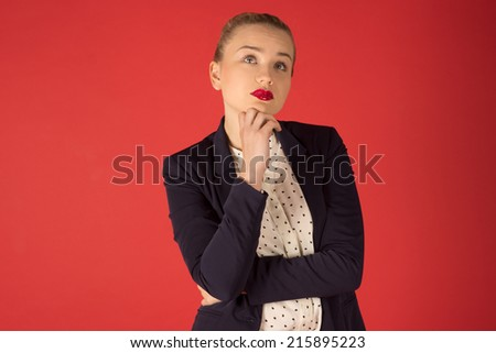 Pensive business woman on a red background - stock photo