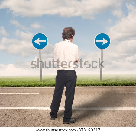 pensive businessman choosing the right direction - stock photo