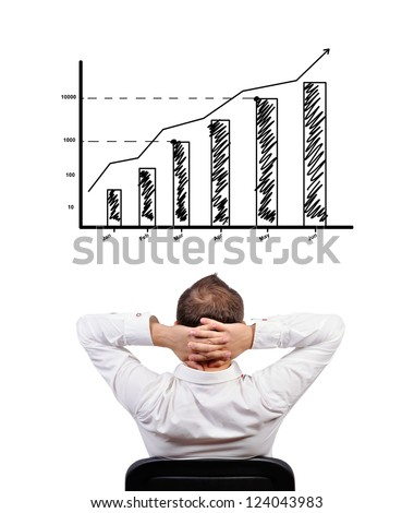 pensive businessman looking at chart of profit - stock photo