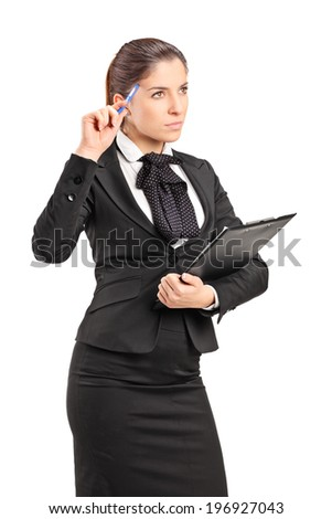 Pensive businesswoman holding a pen against her head isolated on white background - stock photo
