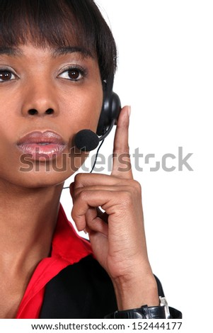 Pensive call-center worker - stock photo
