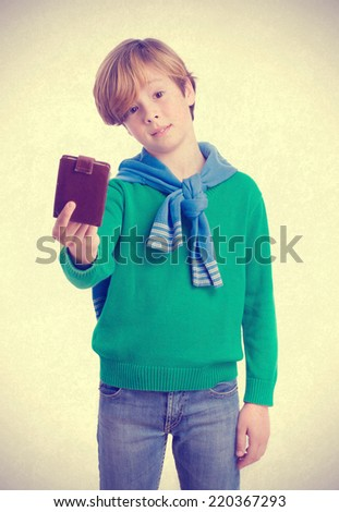 Pensive child holding a leather wallet - stock photo
