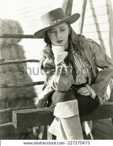 Pensive cowgirl - stock photo