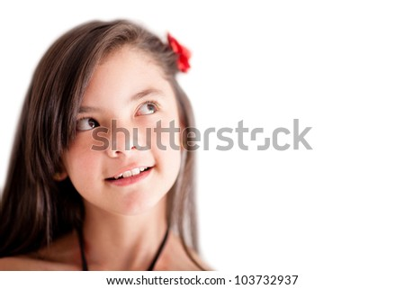 Pensive girl looking up - isolated over  white background - stock photo