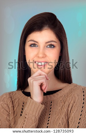Pensive girl smiling isolated on a blue background - stock photo