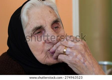 Pensive grandmother  - stock photo