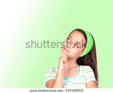 Pensive little girl with a green headband isolated on green background - stock photo