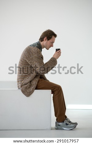 Pensive man in thoughts in simple interior - stock photo