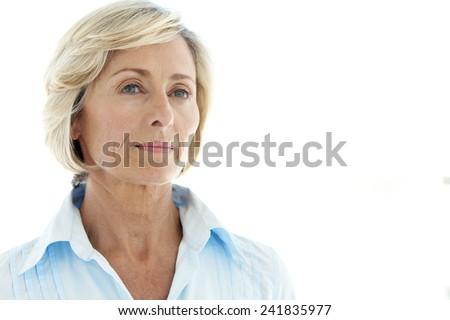 Pensive mature woman. Close up portrait. - stock photo