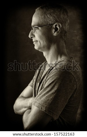 Pensive Middle Age guy in dramatic light. - stock photo