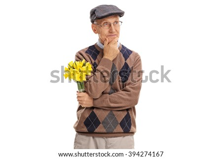 Pensive senior gentleman holding a bunch of flowers and looking in the distance isolated on white background - stock photo