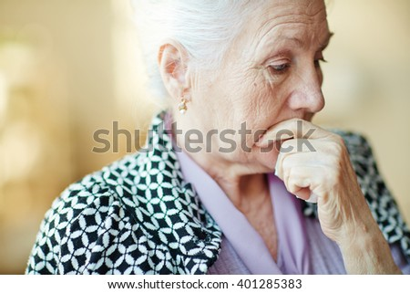 Pensive senior woman - stock photo
