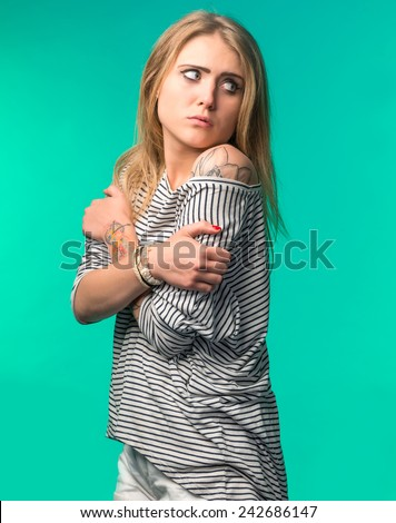 Pensive teenage girl on a green background - stock photo