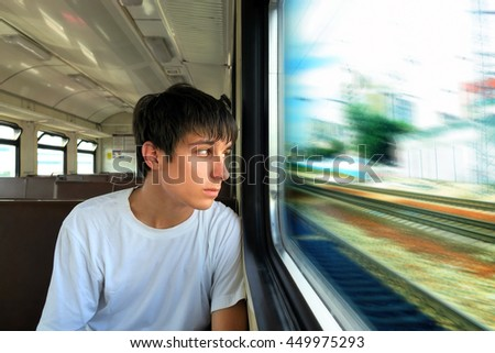 Pensive Teenager sit in the Train - stock photo