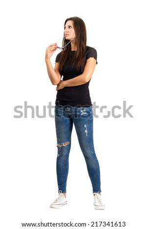 Pensive thinking casual woman with glasses looking away. Full body length isolated over white. - stock photo