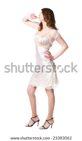 Pensive woman in silver dress. Isolated on white. - stock photo