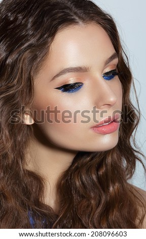 Pensive Woman with Blue Mascara and Holiday Makeup. Visage - stock photo