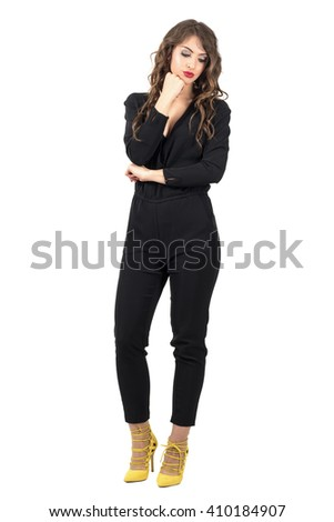 Pensive woman with head resting on her hand looking down. Full body length portrait isolated over white studio background. - stock photo